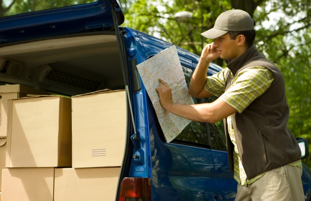 Delivery Driver Looking at Map